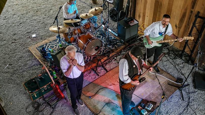 Band singing under barn lights at Mountain Run Winery